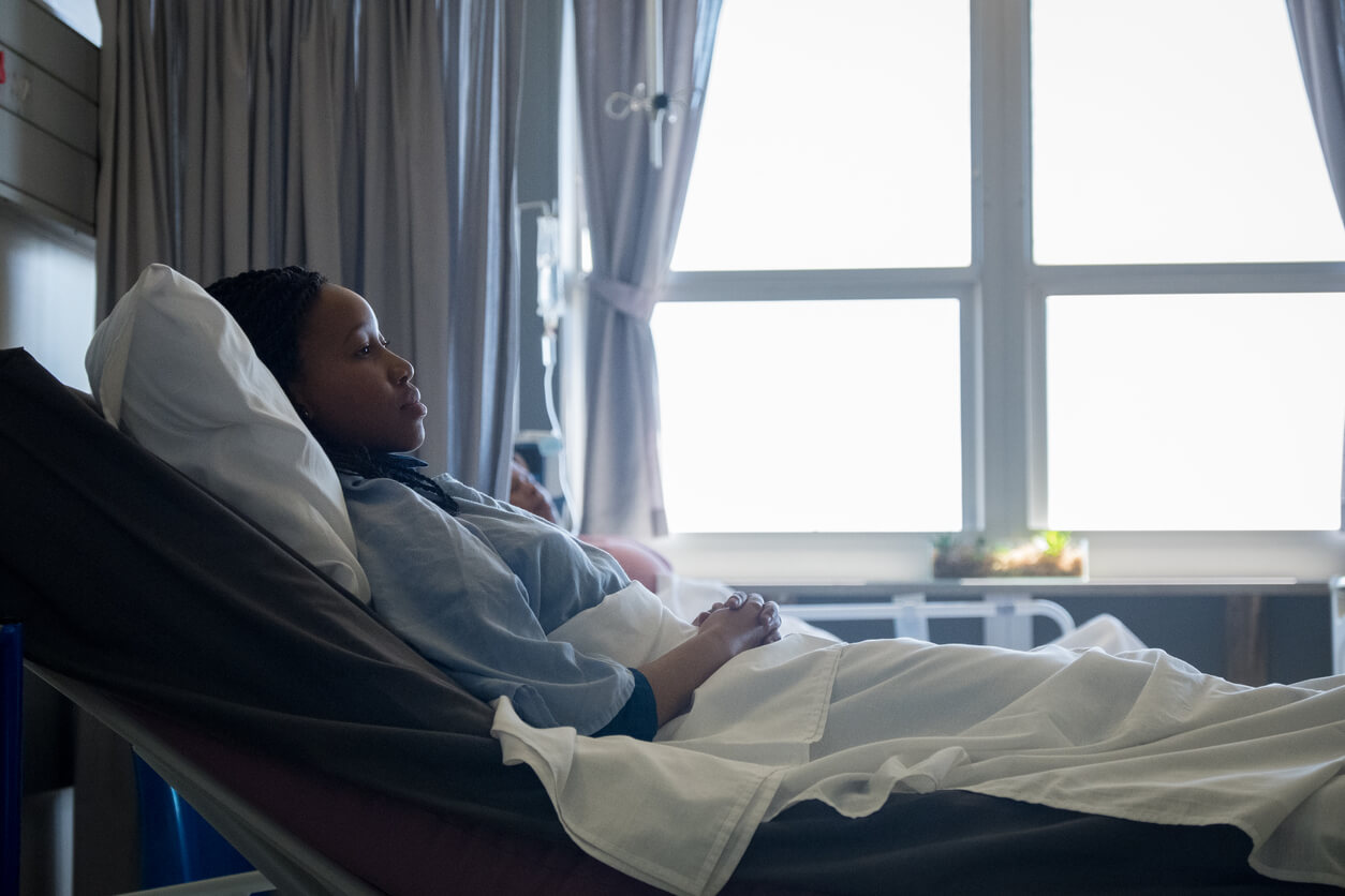 woman with sepsis laying in a hospital bed