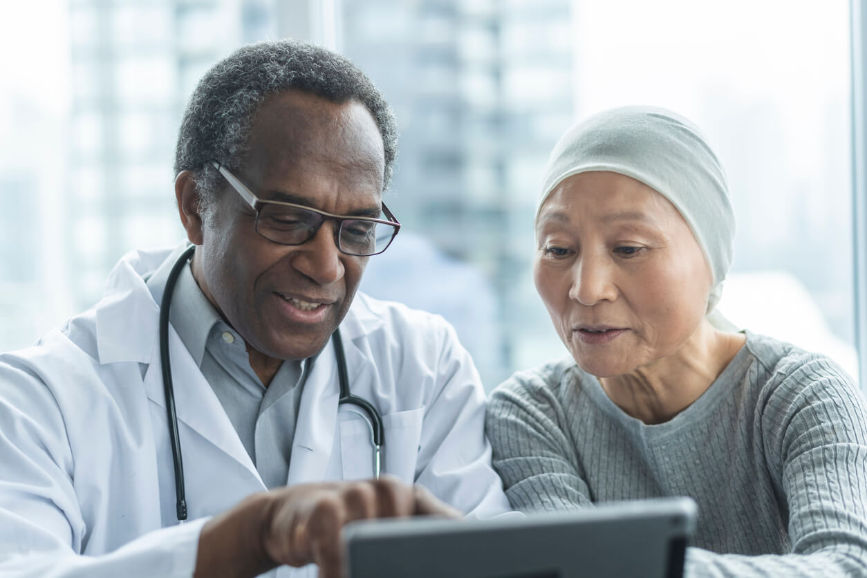 cancer patient reviewing options with doctor